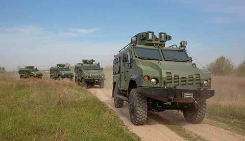 Military vehicles on dirt road